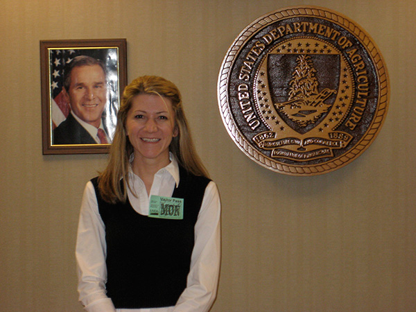 The author on her first advocacy visit, a graduate student intern with the APS Public Policy Board, in the USDA conference room in Washington DC.